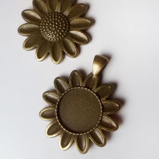 Base colgante flor 18mm, bronce